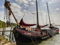 Dutch Barge Volharding At The Old Brickyard Cottages In Suffolk